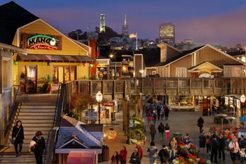 Night view of Pier 39 with San Francisco in the background.